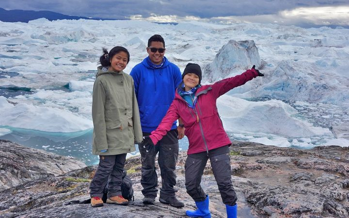 Micronesia area students standing near the Ilulissat Fjord, Greenland. From left: Karen Ehmes of Pohnpei, Dylan Tellei of Palau and Chloe Arnold of Chuuk. Photo: Danko Taborosi.