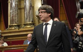 Catalan regional government president Carles Puigdemont arrives to give a speech at the Catalan regional parliament in Barcelona.