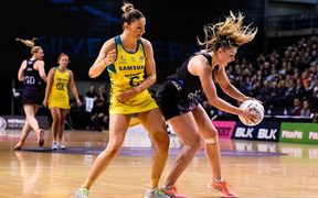 Gina Crampton of the Silver Ferns gets the ball from Kim Ravaillion of the Diamonds during the Constellation Cup netball match 2017.