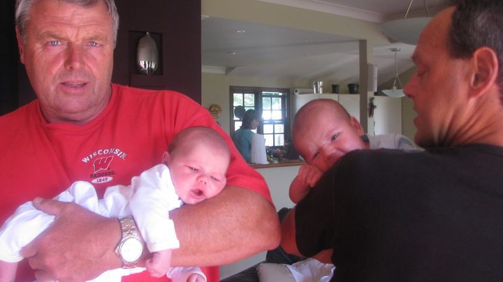 Doug Hopkins (left) holding his grandson Luca, with brother Bruce (right) holding his first grandson, called Charlie.
