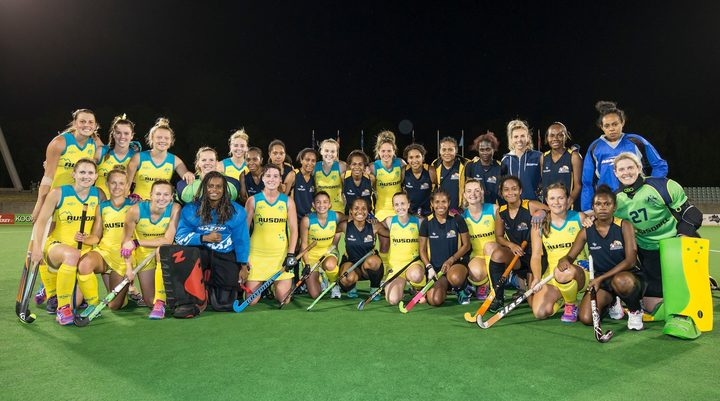 The Australian Hockeyroos and PNG women's team after their Oceania Cup clash.
