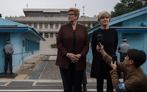 Australia's foreign minister Julie Bishop (right) and defence minister Marise Payne stand on the southern side of the military demarcation line between North and South Korea
