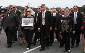 Labour Party leader David Cunliffe, centre, is welcomed onto the marae.