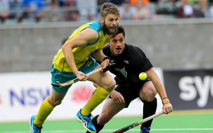 George Muir of the Black Sticks contests a loose ball again Australia during the side's 6-nil loss in the Oceania Cup final.