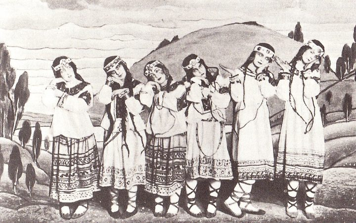 A posed group of dancers in the original production of Igor Stravinsky's ballet The Rite of Spring, showing costumes and backdrop by Nicholas Roerich. The dancers are (left to right) Julitska, Ramberg (en:Marie Rambert), Jejerska, Boni, Boniecka, Faithful.