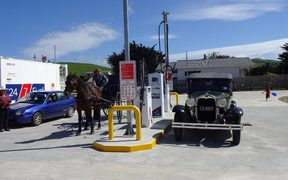 A couple of old-timers fill up at the opening of the new Pongaroa petrol station.