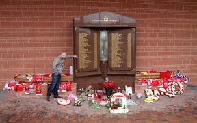 A fan pays his respects at the Hillsborough memorial outside the Anfield stadium