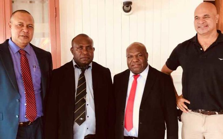 (From left:) Politicians Sam Basil, Kobby Bomareo, Mao Zeming and john Rosso at PNG's Government House for Mr Basil's swearing-in as a minister.