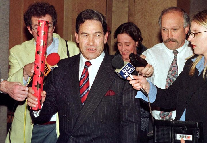 Winston Peters (centre) talking to the media after he was sacked as deputy prime minister by then Prime Minister Jenny Shipley in August 1996. Photo / AFP.