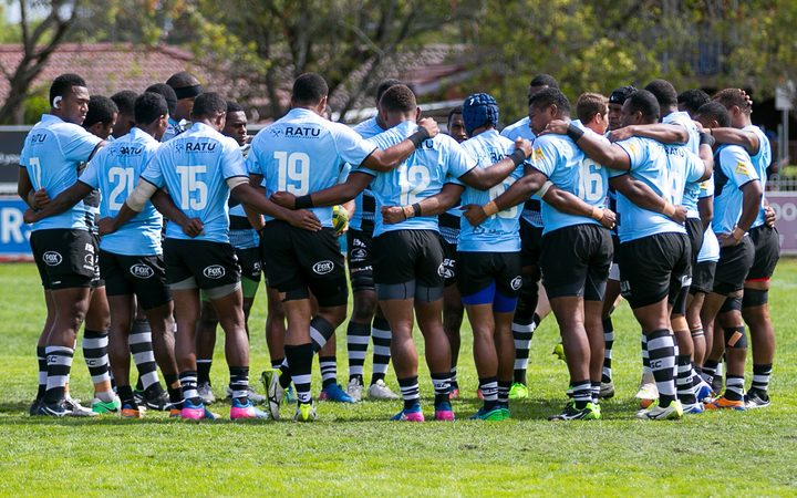 The Fijian Drua huddle together.