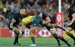 Australia's Israel Folau  is tackled by New Zealand's Sonny Bill Williams, left, and Kieran Read, right.