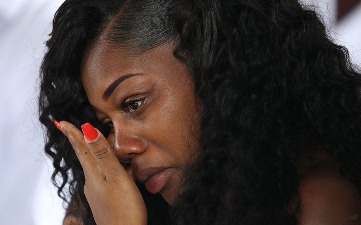 Myeshia Johnson wipes away tears during the burial service for her husband U.S. Army Sgt. La David Johnson at the Memorial Gardens East cemetery on October 21, 2017 in Hollywood, Florida.