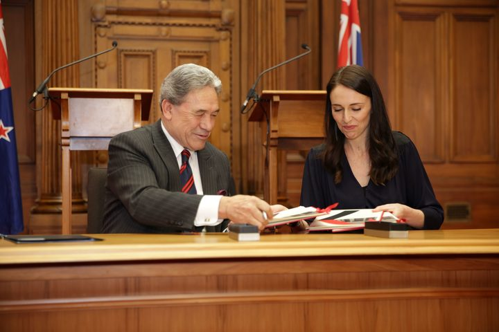 Jacinda Ardern and Winston Peters signing the coalition agreement.