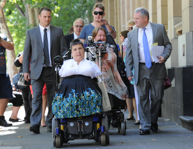 Thalidomide survivors Lynette Rowe (front) and Monica McGhie leave court.