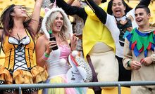 Sevens fans partied despite wet and windy weather.