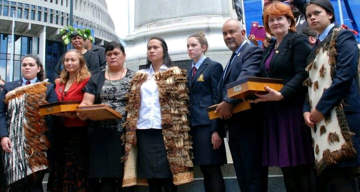 Leah Bell and Waimarama Anderson presenting their petition to parliamentarians