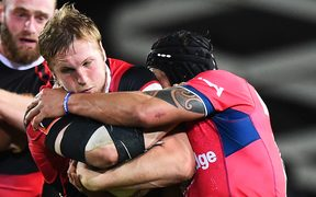 Canterbury's Mitchell Dunshea is tackled by a Tasman player.