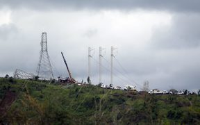 Workers restore high tension power lines damaged by Hurricane Maria in Guayama, Puerto Rico.