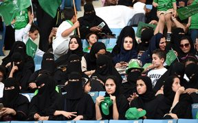 Saudi women sit in a stadium for the first time to attend an event in the capital Riyadh in September, commemorating the anniversary of the founding of the kingdom.