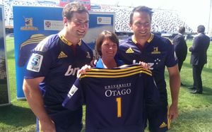 Vice-Chancellor Harlene Hayne with Craig Millar, left, and co-captain Ben Smith.