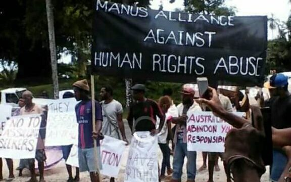 Local Manusians demonstrate in support of the refugees.