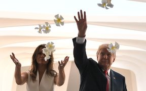 US President Donald Trump and First Lady Melania Trump throw flowers during their visit to the USS Arizona Memorial in Hawaii.