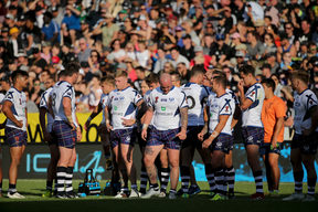 Dejected looking Scotland team after losing to the Kiwis