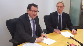 Finance Minister Grant Robertson re-signing the current Policy Targets Agreement with Reserve Bank Acting Governor Grant Spencer.