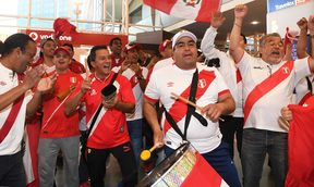 Peru football fans celebrate the arrival of their team at Auckland Airport.