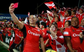 Tonga's Tuimoala Lolohea is all smiles with fans after beating Samoa.