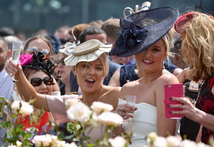 Racegoers at 156th Melbourne Cup last year.