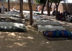 Bodies laid out for burial in the village of Konduga.