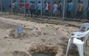 Manus Island refugees and one of their wells.