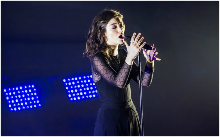 Lorde on stage at the Dunedin Town Hall