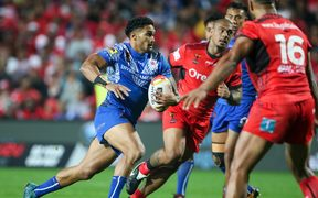 Samoa's Fa'amanu Brown looks to breach the Tongan defence.