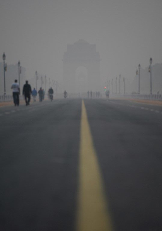 Smog covers India Gate war memorial in New Delhi.