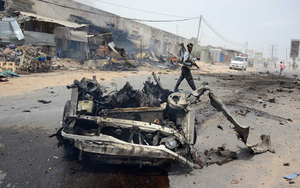 The wreckage of a car shortly after it exploded near the entrance to Mogadishu international airport.