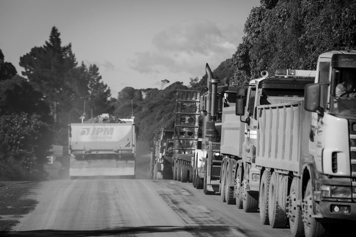 Hundreds of trucks and heavy machinery line the road along the coast. SH1 north of Kaikoura is due to open on December 15th.