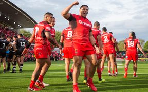 Tonga's Jason Taumalolo and Konrad Hurrell celebrate their win over the Kiwis.