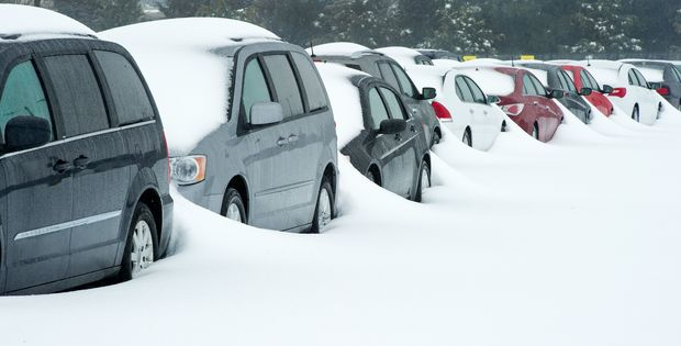 Rental cars covered with snow at Dulles international airport in Virginia.