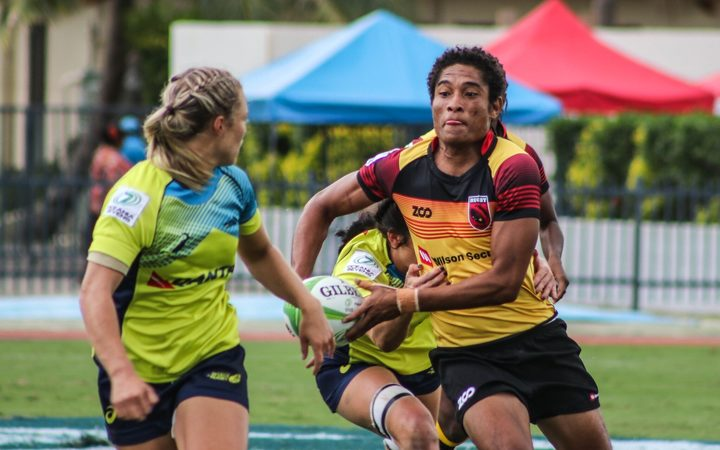 PNG Palais captain Joanne Lagona takes on the Australian defence.