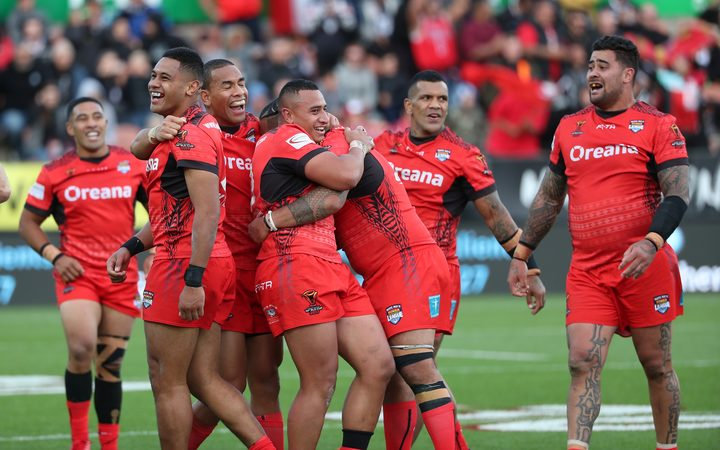 Tonga are all smiles after beating New Zealand to finish atop Group B.