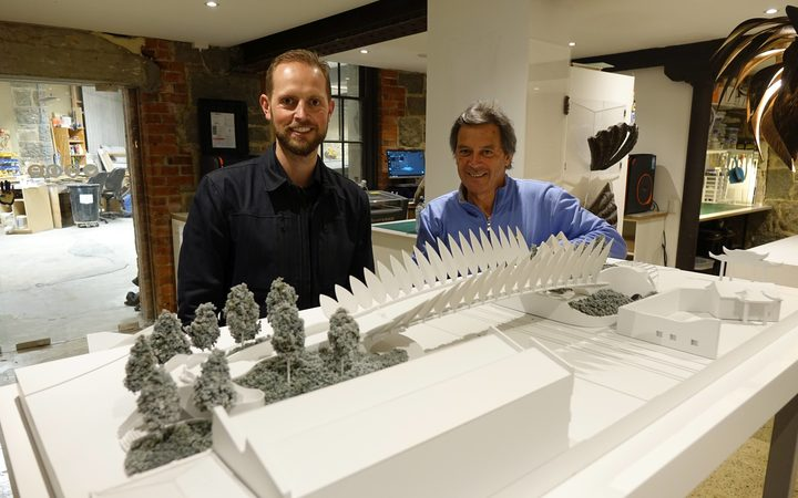 Architect Damien van Brandenburg and Animation Research Ltd chief executive Ian Taylor inspect a 3D-printed model of Mr van Brandenburg's proposal for an overbridge linking central Dunedin and the waterfront.