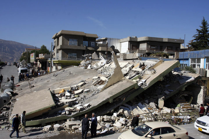 A building in the town of Darbandikhan, in Iraq's Kurdistan region, levelled by the quake.