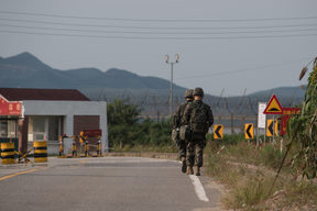 South Korean soldiers walk to a checkpoint at the Demilitarized zone (DMZ) separating North and South Korea, on Ganghwa island.
