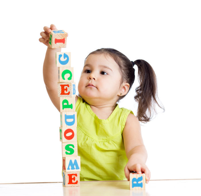 A photo of a girl playing with block toys on white background