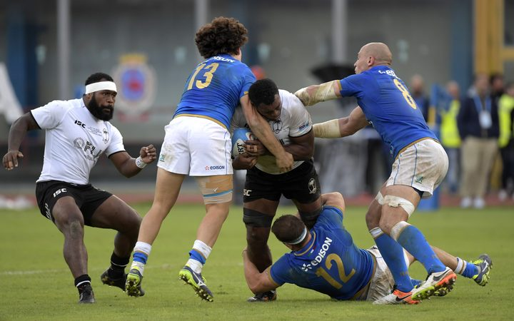 Fiji number 8 Nemani Nagusa is tackled by Italy's Tommaso Castello, Tommaso Boni and Sergio Parisse during their test in Catania.