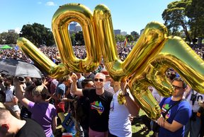 "Supporters of the same-sex marriage ""Yes"" vote celebrate in a Sydney park shortly after the announcement."