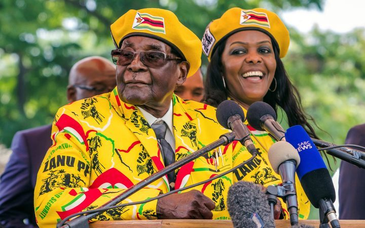 Zimbabwe's president Robert Mugabe and wife Grace Mugabe at the ruling party's headquarters.