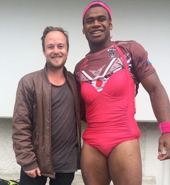 Mikaele Ravalawa of Fiji sporting the team's 'pink dress', reserved as punishment for misdeeds in camp.